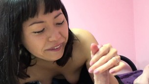 Adorable Asian slut sucking on that veiny cock