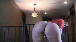 Girl shakes her big pouch in a crimson sundress